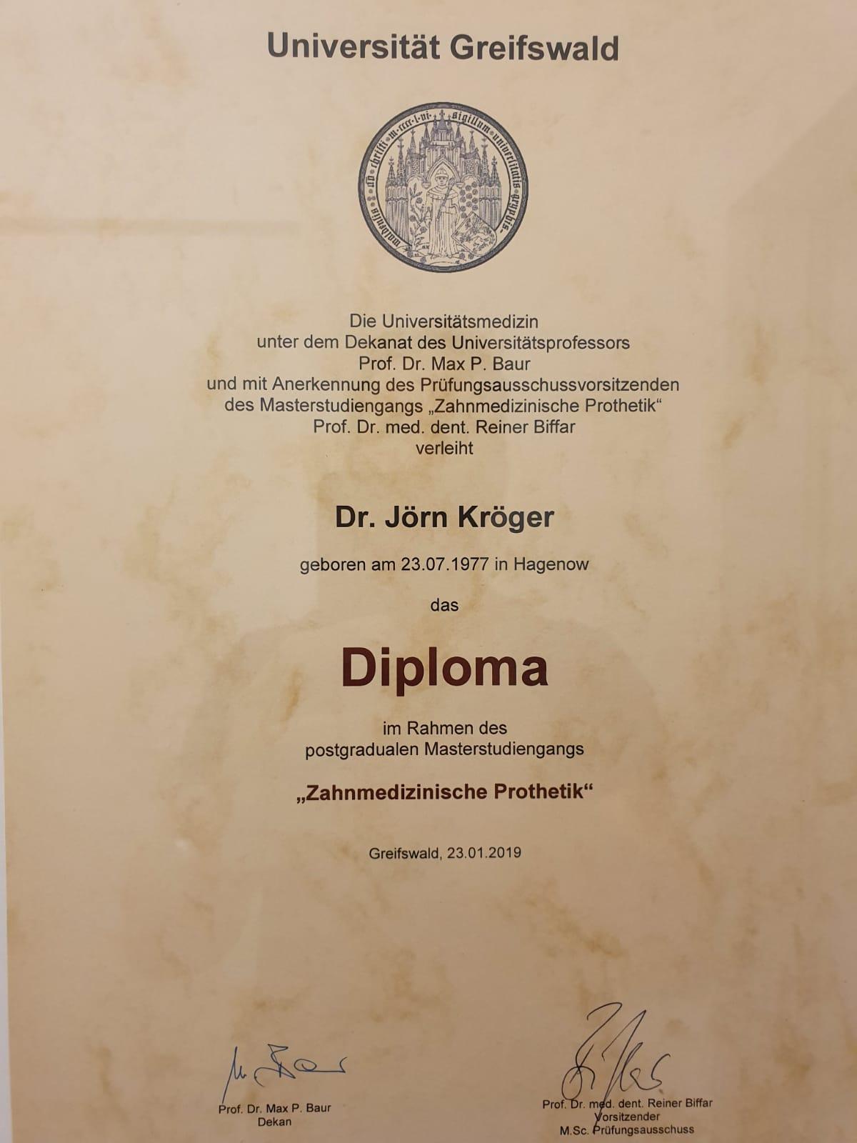 Diploma in Zahnmedizinische Prothetik von Dr. Jörn Kröger, Zahnarzt Berlin-Spandau.
